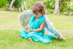 Cute angel girl on natural background. Cute angel girl on green natural background Royalty Free Stock Image