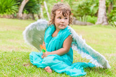 Cute angel girl on natural background. Cute angel girl on green natural background Stock Images