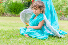 Cute angel girl on natural background. Cute angel girl on green natural background Stock Photo