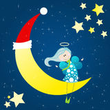 Cute angel sitting on the moon. Cute angel sitting on a christmas moon Royalty Free Stock Photography