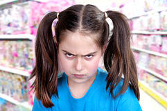 Cute angry girl. With funny grimace royalty free stock images