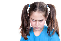 Cute angry girl with funny grimace. On white background stock photos