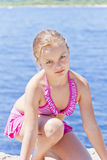 Cute angry girl in pink swimsuit Stock Photo