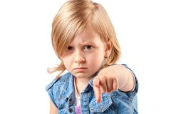 Cute angry girl pointing up. Portrait of a young angry girl pointing up Royalty Free Stock Images