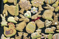 Cute animals, Easter homemade hand painted gingerbread cookies. Spread on black background stock photography