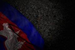 Cute any feast flag 3d illustration - dark picture of Cambodia flag with big folds on dark asphalt with free space for content. Nice dark photo of Cambodia flag stock illustration