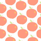 Cute apples seamless vector background. Red apples with an orange side and a green leaf Royalty Free Stock Image