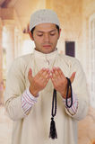 Cute arabian guy holding a masbaha with his hands Stock Image