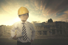 Cute architect with a blueprint Royalty Free Stock Images