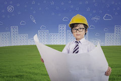 Cute architect boy holding plan outdoor Stock Photo