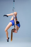 Cute artistic gymnast exercising with hanging hoop Stock Images