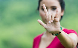 Cute asain woman showing I love you hand gesture Stock Photo