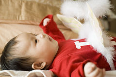Cute asia baby. With feather toy Stock Image