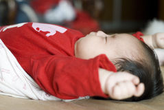 Cute asia baby stretching. Cute asia baby is stretching after sleeping Royalty Free Stock Photo