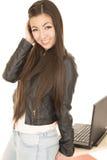 Cute Asian American teen girl by her computer posing Stock Photos