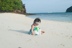 Cute asian baby on the beach. Royalty Free Stock Image