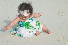 Cute asian baby on the beach. Stock Image