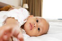 Cute asian baby girl on bed Royalty Free Stock Photos