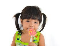 Cute asian baby girl and big lollipop Stock Photos
