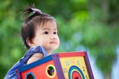 Cute asian baby girl playing with her toy Stock Images