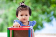 Cute asian baby girl playing with her toy Stock Photos