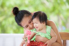 Cute asian baby girl smiling and playing with her mother Royalty Free Stock Image