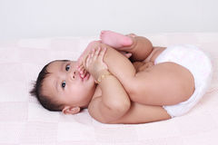 Cute Asian Baby Girl Sucking Her Toes Stock Images