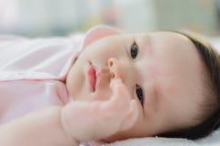 Baby girl wake up. Cute asian baby girl wake up - close up stock photography