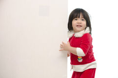 Cute asian baby in santa costume with whiteboard Stock Images