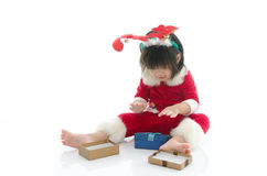 Cute asian baby wearing santa costume with present Royalty Free Stock Images