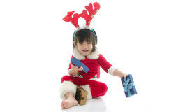 Cute asian baby wearing santa costume with present Stock Image