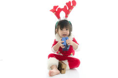 Cute asian baby wearing santa costume with present Stock Photo