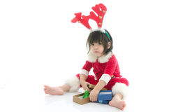 Cute asian baby wearing santa costume with present Stock Images