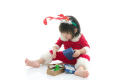 Cute asian baby wearing santa costume with present Stock Photos