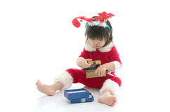 Cute asian baby wearing santa costume with present Royalty Free Stock Image