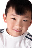 Cute asian boy. One young cute asian boy headshot portrait looking happy over white Stock Photography