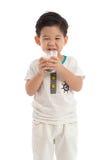 Cute asian boy drinking milk