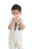 Cute asian boy drinking milk Royalty Free Stock Photography