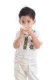 Cute asian boy drinking milk Royalty Free Stock Photography