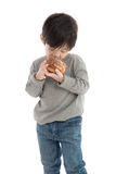 Cute asian boy eating cream puff Stock Photo