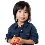 Cute asian boy holding apple. Stock Image
