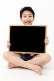 Cute asian Boy Holding Blank board Royalty Free Stock Photo