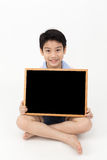 Cute asian Boy Holding Blank board Royalty Free Stock Photography