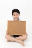 Cute asian Boy Holding Blank board Stock Image