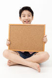 Cute asian Boy Holding Blank board Royalty Free Stock Images