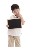 Cute asian boy holding chalkboard on white background Stock Photos