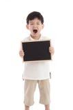 Cute asian boy holding chalkboard on white background Stock Image