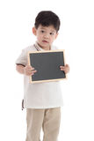 Cute asian boy holding chalkboard on white background Royalty Free Stock Photos