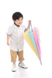 Cute Asian Boy Holding Umbrella Royalty Free Stock Photos