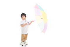 Cute Asian Boy Holding Umbrella Stock Image
